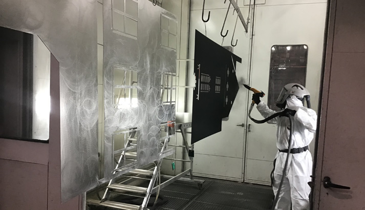 Painting the sets in the workshop